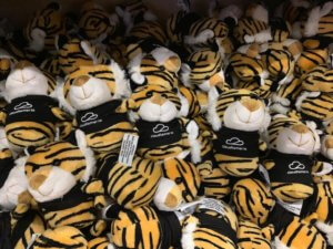 a bunch of stuffed tiger giveaways at booth